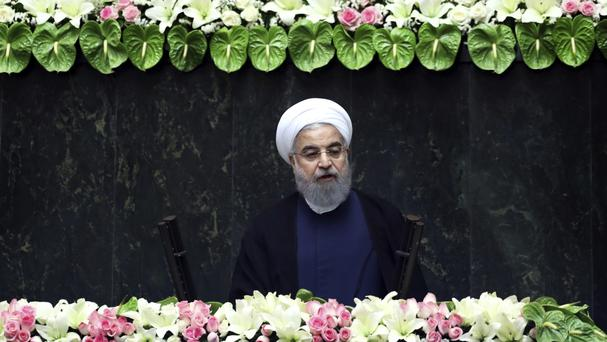Hassan Rouhani's remarks follow the Iranian parliament's move earlier this week to increase spending on the country's ballistic missile programme (AP/Ebrahim Noroozi)
