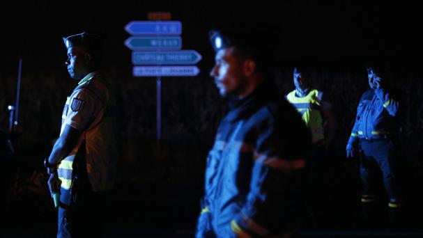 Police officers block a road approaching the town of Sept-Sorts (AP/Kamil Zihnioglu)