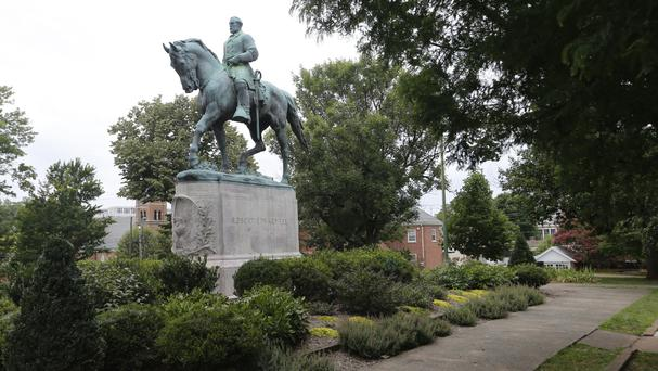 The statue of Confederate general Robert E Lee still stands in Lee Park in Charlottesville, Virginia (Steve Helber/AP)