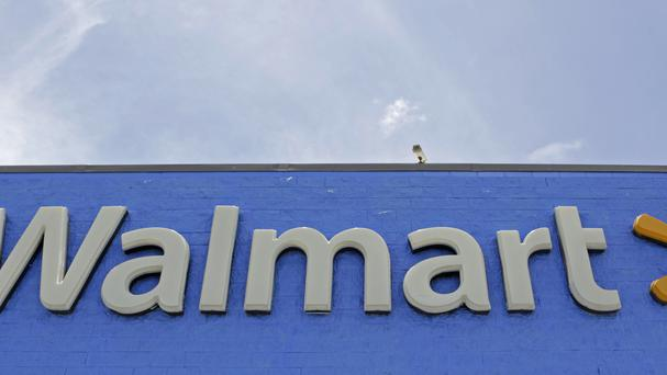 The sweltering tractor-trailer was found at a Texas Walmart store car park (AP Photo/Alan Diaz)