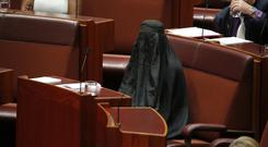 Senator Pauline Hanson wears a burka during question time in the Senate chamber at Parliament House in Canberra (Jed Cooper/Australian Broadcasting Corp. via AP)