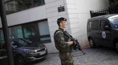 A soldier near the scene where French soldiers were hit and injured by a vehicle in the western Paris suburb of Levallois-Perret (Kamil Zihnioglu)