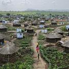 A sprawling complex of mud-brick houses and tents makes up the Bidi Bidi refugee settlement in northern Uganda (Ben Curtis/AP)