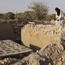 Mohamed Maouloud Ould Mohamed, a mausoleum caretaker, prays at a damaged tomb in Timbuktu, Mali (Baba Ahmed/AP)