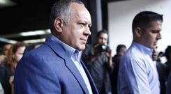 Ruling socialist party leader Diosdado Cabello, pictured, provided prosecutors with papers allegedly showing that Mr Ferrer and others opened six bank accounts at the Bahamas branch of a Swiss bank (AP)