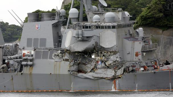 The damaged USS Fitzgerald docked in Yokosuka after colliding with a Philippine-flagged container ship off Japan in June (AP Photo/Eugene Hoshiko, File)