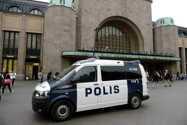 Finnish police patrol in front of the Central Railway Station Photo: Reuters