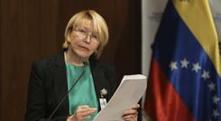 Luisa Ortega fled to Colombia with her husband German Ferrer, a day after Venezuela's Supreme Court ordered his arrest (AP Photo/Fernando Llano, File)