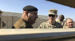 Lt Gen Stephen Townsend, pictured speaking with an Iraqi officer in February, said there will be an assault on the IS-held area of Tal Afar (AP Photo/ Ali Abdul Hassan, File)