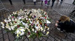 Tributes for the victims of an attack in Turku, Finland (Vesa Moilanen/Lehtikuva via AP)