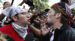 A counter-protester, left, confronts a professed supporter of President Donald Trump at the Free Speech rally (AP/Michael Dwyer)