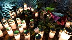 Tribute: Flowers and candles at Turku market square in the Finnish city where two people were stabbed to death. Photo: AFP/Getty