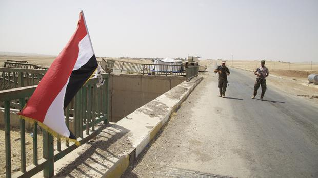 Iraqi soldiers guarding a bridge on the road to Tel Afar, as the operation to retake the town from Islamic State began (AP/Balint Szlanko)