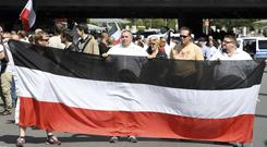 Far-right extremists gather to commemorate the death of Rudolf Hess in Berlin's western district of Spandau (Maurizio Gambarini/dpa via AP)
