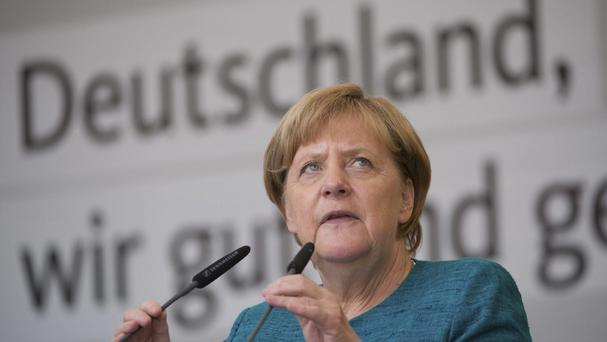 Angela Merkel speaks during an election campaign event (Sebastian Kahnert/dpa via AP)