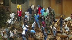 Volunteers search for victims of the disaster in Sierra Leone (AP/Manika Kamara)