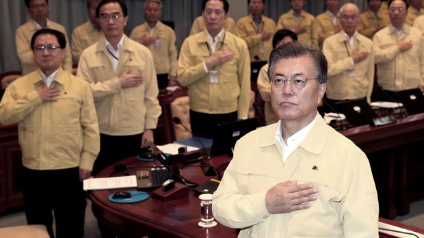South Korean President Moon Jae-in, right, said on Monday the drills are defensive in nature (Kim Ju-hyung/Yonhap via AP)