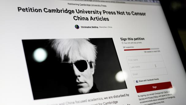 A computer screen shows an online petition page urging Cambridge University Press to restore more than 300 politically sensitive articles removed from its website in China (AP)