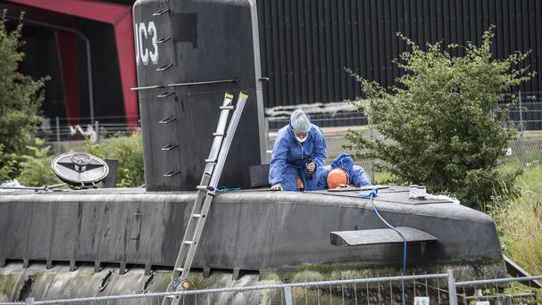 Police technicians board the amateur-built submarine UC3 Nautilus on a pier in Copenhagen harbour (Mogens Flindt/Ritzau Foto via AP)