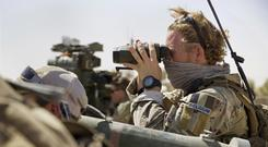 A Belgian special forces soldiers looks through his binoculars near the frontline east of Tal Afar, Iraq (AP)