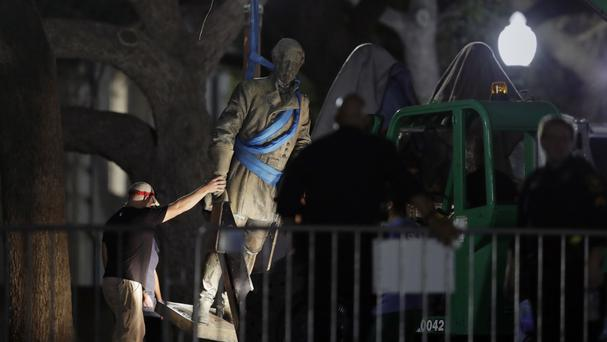 A statue of Confederate General Robert E Lee is removed from the University of Texas campus in Austin (AP)