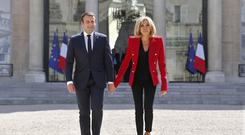 France's President Emmanuel Macron dropped the idea of creating a special budget for his wife after a petition with more than 280,000 signatures (AP)