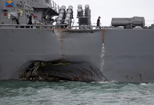 The U.S. Navy guided-missile destroyer USS John S. McCain is seen after a collision, in Singapore waters. Photo: Reuters
