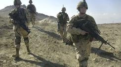 US soldiers on patrol near Bagram military base (AP)