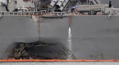 The damaged hull of the USS John S McCain is visible at Singapore's Changi naval base (AP)