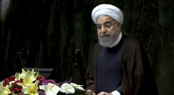 President Hassan Rouhani warned Iran could ramp up its nuclear programme if the US continues 'threats and sanctions' against his country (AP Photo/Vahid Salemi)