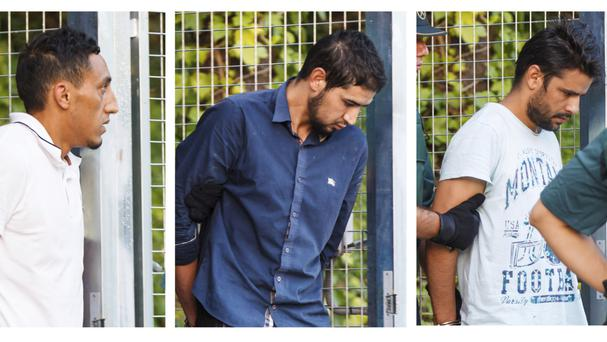 Suspects leave a Civil Guard base on the outskirts of Madrid before appearing in court (AP)