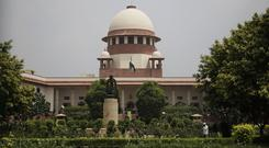 The Supreme Court deliberated for three months before issuing its order in response to petitions from seven Muslim women (AP)