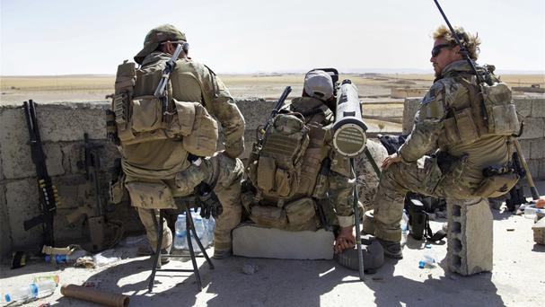 Troops on the front line in the village of Abu Ghaddur, east of Tal Afar (AP)