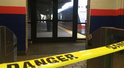 Police tape blocks off a train track at the 69th Street Terminal in Upper Darby (AP)