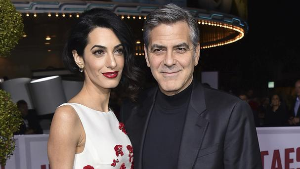 The couple's Clooney Foundation for Justice is supporting the Southern Poverty Law Centre (Invision/AP)