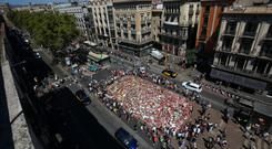 People gather at an impromptu memorial where a van crashed into pedestrians at Las Ramblas in Barcelona. Photo: REUTERS