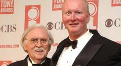 Thomas Meehan, left, and Mark O'Donnell pose with their Tony awards for Hairspray in 2003 (AP)