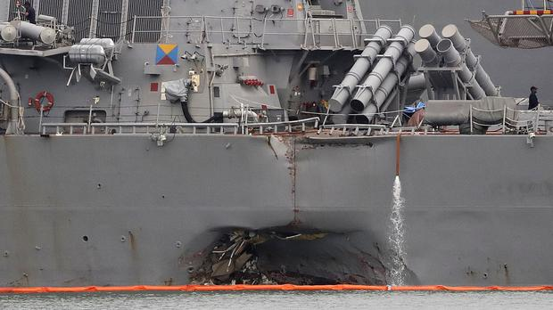 The damaged port aft hull of the USS John S McCain following the collision with an oil tanker (AP)