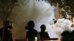 Phoenix police use tear gas against protesters opposing Donald Trump (AP)