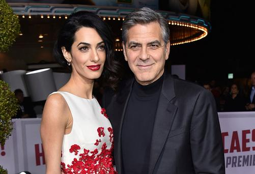 Amal Clooney, left, and George Clooney. Photo: AP