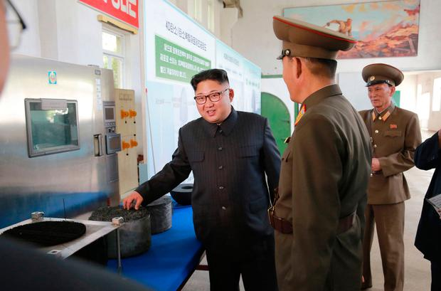 Kim Jong-un visits North Korea's Chemical Material Institute of Academy of Defence Science. Photo: AP