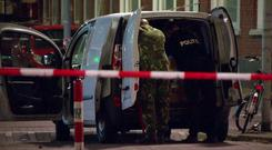 Police examine the van behind a cordoned-off area (RTL/AP)