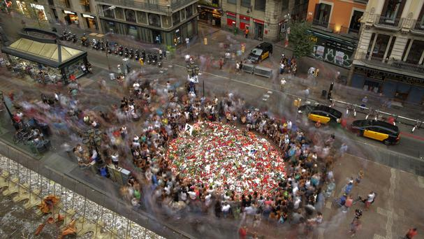 People pay respects at a memorial tribute of flowers, messages and candles to the attack victims on Barcelona's Las Ramblas (AP)