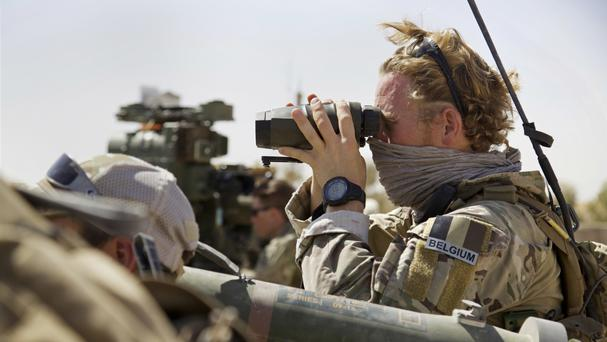 A Belgian special forces soldiers looks through his binoculars near the frontline, east of Tal Afar, Iraq (AP)