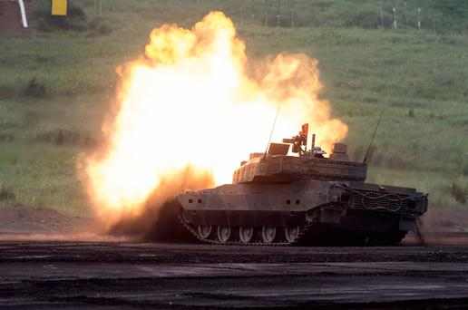 A Japanese battle tank taking part in a live-fire exercise at the foot of Mount Fuji, Japan yesterday. The four-day annual drills take place amid rising tensions between North Korea and the United States. Photo: Getty Images