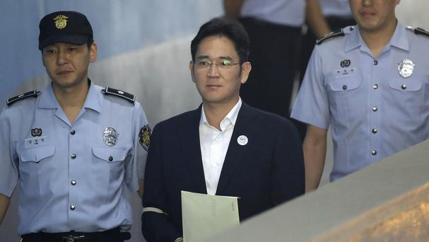 Samsung heir Lee Jae-yong arrives for his trial at Seoul Central District Court (AP)