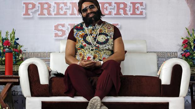 Gurmeet Ram Rahim Singh Ji Insan at a movie premiere in New Delhi (AP)
