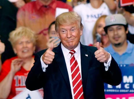 Donald Trump gives a thumbs up to supporters during a rally on Tuesday in Phoenix, Arizona. Photo: Ralph Freso/Getty
