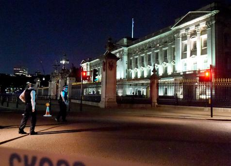 Police outside Buckingham Palace in London last night after the attack. Photo: Lauren Hurley/PA