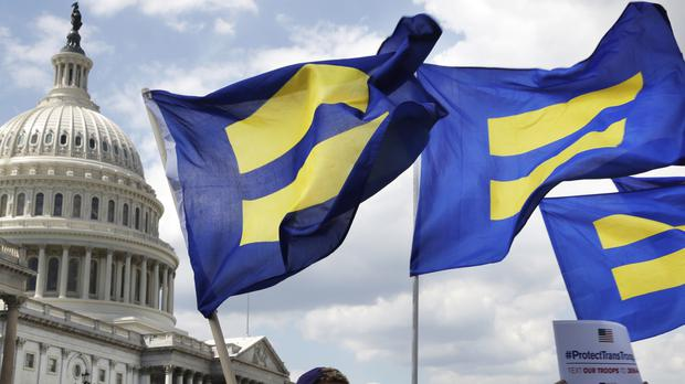 Human Rights Campaign members fly 'equality flags' on Capitol Hill in support of transgender military members (AP)